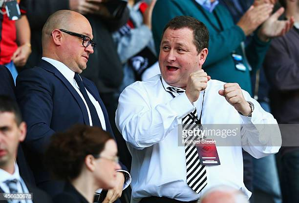 Newcastle United owner Mike Ashley in discussion with managing director Lee Charnley prior to the Barclays Premier League match between Swansea City...