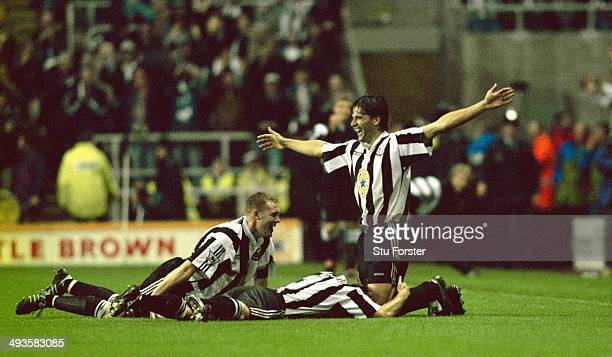 Newcastle United player Phillipe Albert celebrates with Steve Watson and John Beresford after his goal had put Newcastle 5 nil up during the Premier...