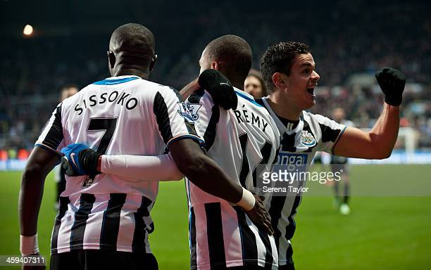 Newcastle United players Hatem Ben Arfa and Moussa Sissoko celebrate with Loic Remy who scored the second goal during the Barclays Premier League...