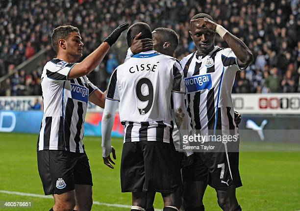 Newcastle United Players Hatem Ben Arfa Massadio Haidara and Moussa Sissoko celebrate with Papiss Cisse after he scores during the Budweiser FA Cup...