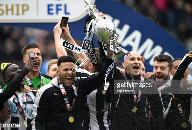 Newcastle United players Jaamal Laschelles and Jonjo Shelvey lift the trophy after winning the Sky Bet Championship match between Newcastle United...