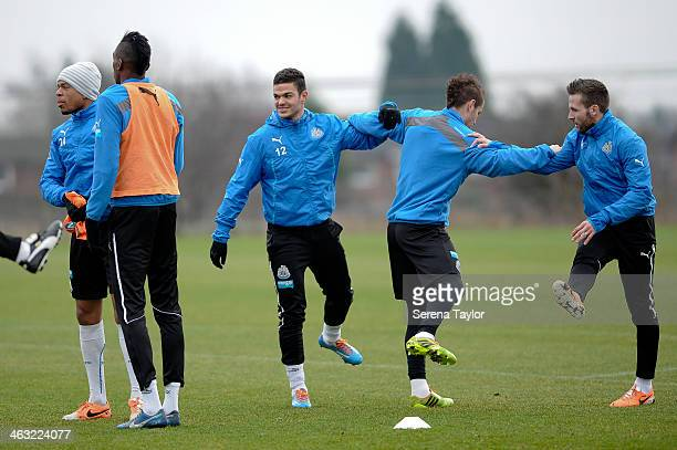Newcastle United players seen Loic Remy Sammy Ameobi Hatem Ben Arfa Mathieu Debuchy and Yohan Cabaye warm up during a training session at The...
