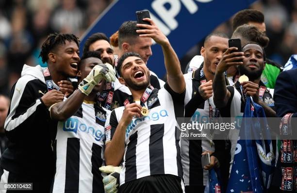 Newcastle United players Vurnon Anita and Achraf Lazaar celebrate by taking selfie photographs after winning the Sky Bet Championship match between...