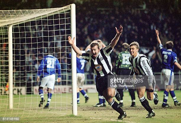 Newcastle United striker Alan Shearer celebrates with Lee Clark after completing his hat trick and a 43 FA Premier League win for Newcastle after...