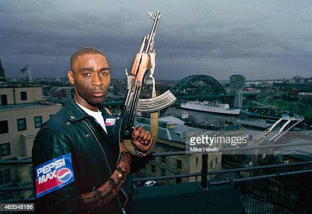 Newcastle United striker Andy Cole pictured holding a gun on a sponsors shoot overlooking the city of Newcastle on January 26 1994 in Newcastle Upon...
