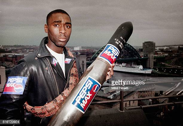Newcastle United striker Andy Cole pictured holding a missile during a sponsors shoot overlooking the city of Newcastle on January 26 1994 in...