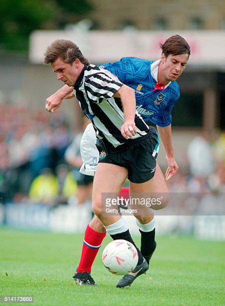 Newcastle United striker David Kelly beats Portsmouth defender Kit Symons to the ball during a Division One clash at St Jame's Park on September 12...