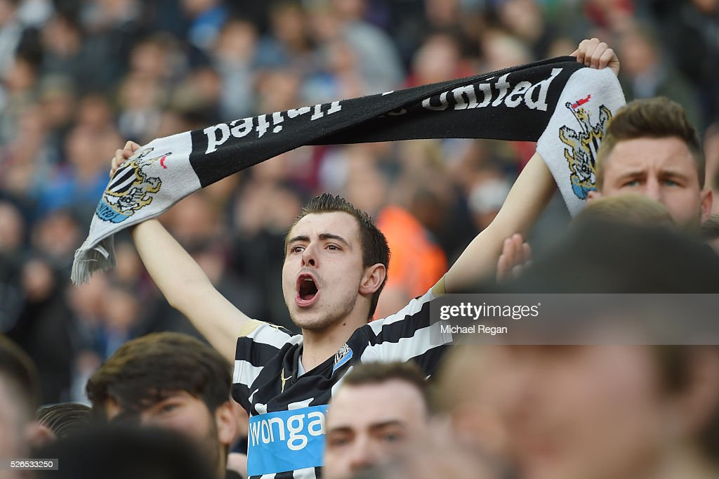 Newcastle United supporter cheers during the Barclays Premier League match between Newcastle United and Crystal Palace at St James' Park on April 30, 2016 in Newcastle upon Tyne, England.