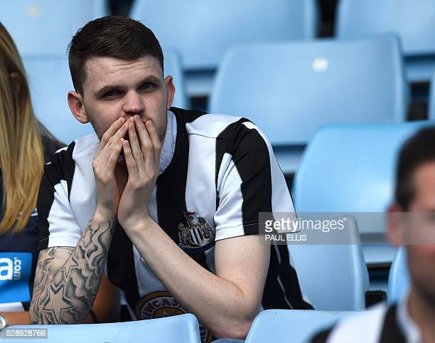 A Newcastle United supporter reacts to the news that their rivals Sunderland have won putting them in danger of relegation after the English Premier...