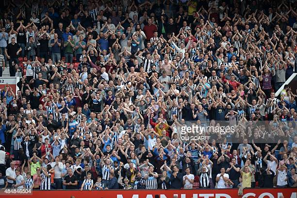 Newcastle United supporters celebrate the result after the English Premier League football match between Manchester United and Newcastle United at...