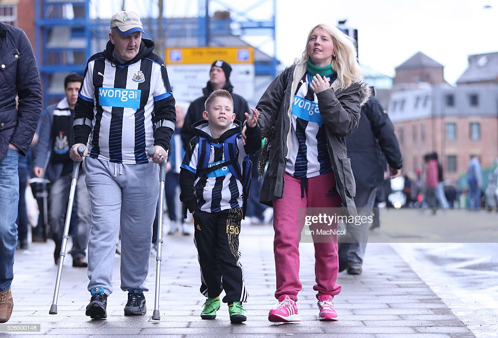 Newcastle United supporters make their way to the stadium prior to the Barclays Premier League match between Newcastle United and Crystal Palace at St James' Park on April 30, 2016 in Newcastle upon Tyne, England.