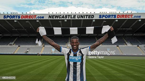 Newcastle United unveil summer signing Georginio Wijnaldum holding a Newcastle United Scarf above his head at StJames' Park on July 10 in Newcastle...