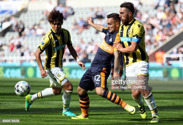 Newcastle United's Adam Armstrong battles for the ball with Vitesse Arnhem's Guram Kaashia