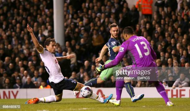 Newcastle United's Adam Armstrong has a shot which is blocked by Tottenham Hotspur's Benjamin Stambouli and Michel Vorm