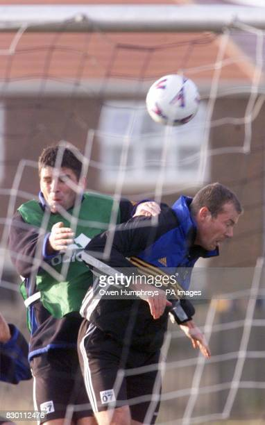 Newcastle United's Alan Shearer and team mate Philippe Albert in mid air action during a training session at Chester le Street Friday December 18 1998