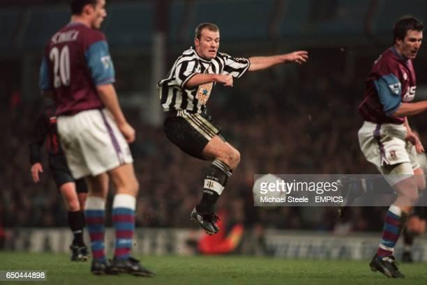 Newcastle United's Alan Shearer has a shot blocked by Aston Villa's Simon Grayson as Riccardo Scimeca looks on