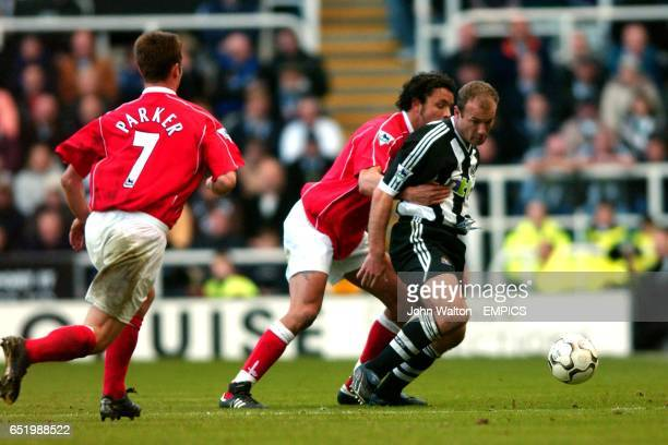 Newcastle United's Alan Shearer is held back by Charlton Athletic's Mark Fish as Scott Parker comes in to help