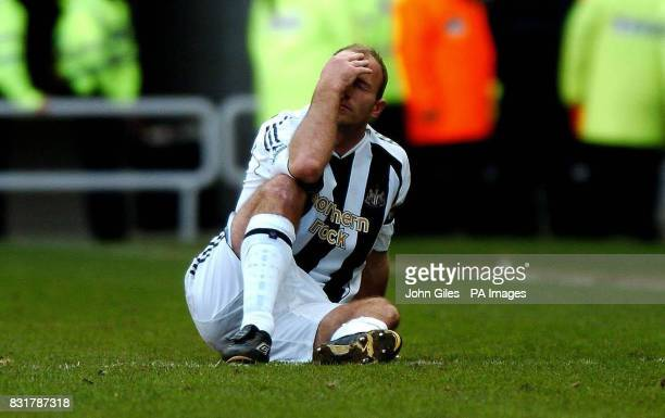 Newcastle United's Alan Shearer shows his dejection as he sits injured during the Barclays Premiership match against Sunderland at the Stadium of...