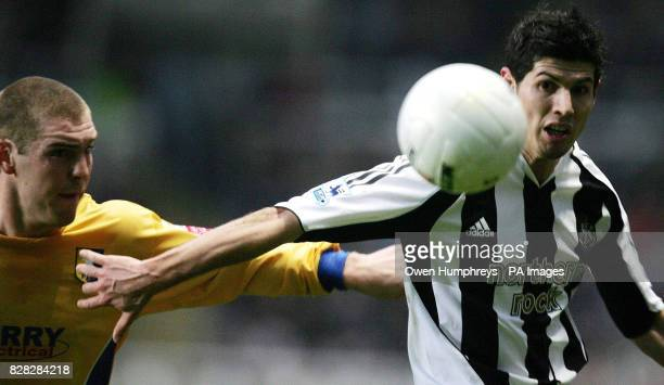 Newcastle United's Albert Luque battles for the ball with Mansfield's Jake Buxton during the FA Cup Third Round match at St James' Park Newcastle...