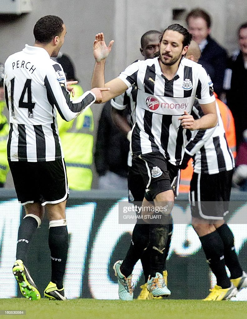 Newcastle United's Argentinean midfielder, Jonas Gutierrez (R) celebrates scoring their first goal against Chelsea with teammate James Perch (L) during the English Premier League football match between Chelsea and Newcastle United at St James Park, Newcastle upon Tyne, England, on February 2, 2013. USE. No use with unauthorized audio, video, data, fixture lists, club/league logos or 'live' services. Online in-match use limited to 45 images, no video emulation. No use in betting, games or single club/league/player publications.