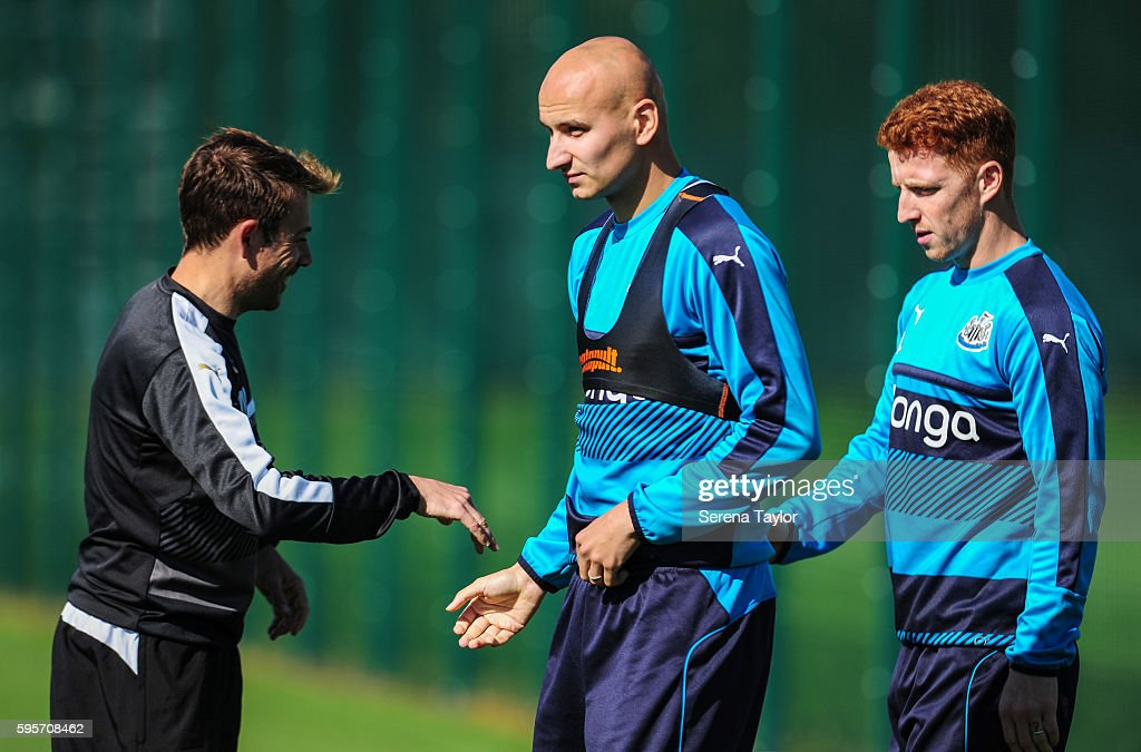 Newcastle United's Assistant Manager Francisco De Miguel Moreno shakes hands with Jonjo Shelvey and Jack Colback during the Newcastle United Training...