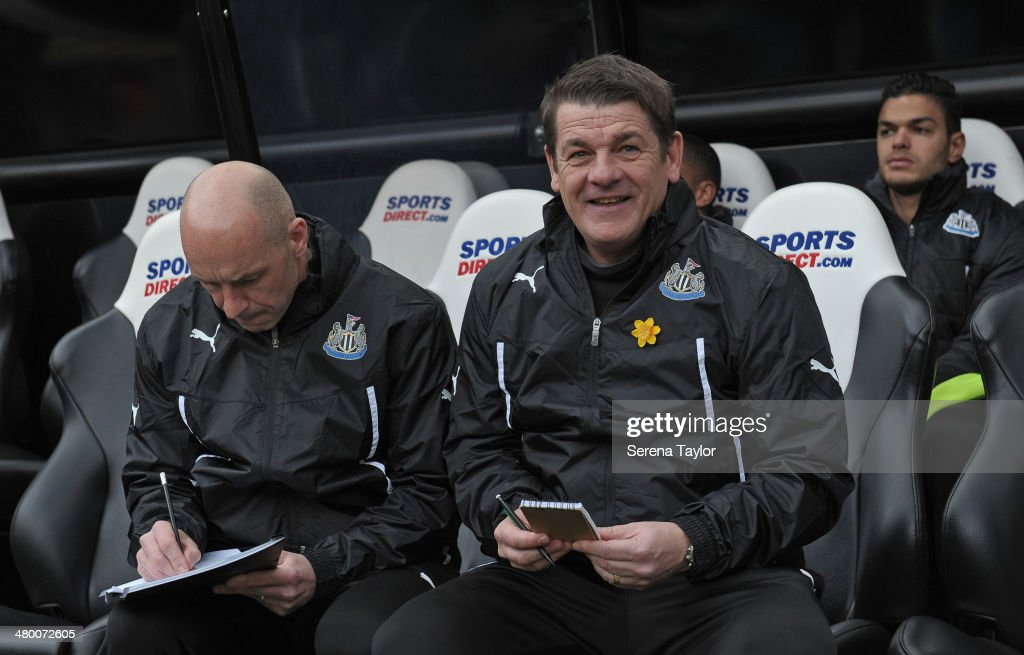 Newcastle United's Assistant Manager John Carver (R) smiles and First Team Coach Steve Stone (L) writes in the dugouts prior to kick off at the Barclays Premier League match between Newcastle United and Crystal Palace at St. James' Park on March 22, 2014, in Newcastle upon Tyne, England.