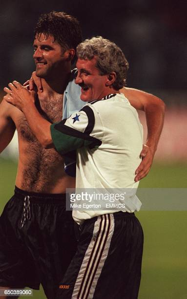 Newcastle United's assistant manager Terry McDermott and Philippe Albert celebrate
