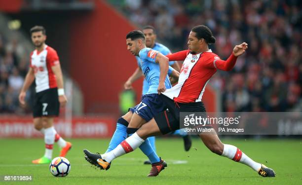 Newcastle United's Ayoze Perez and Southampton's Virgil van Dijk battle for the ball during the Premier League match at St Mary's Southampton