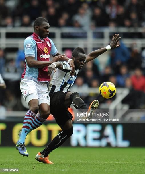 Newcastle United's Cheick Tiote and Aston Villa's Christian Benteke battle for the ball