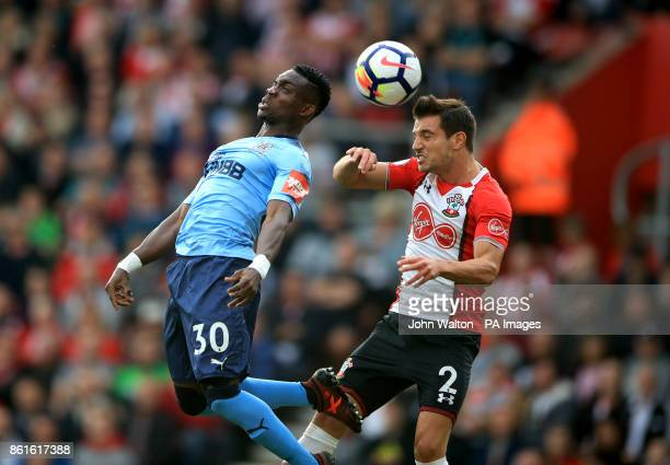 Newcastle United's Christian Atsu and Southampton's Cedric Soares battle for the ball during the Premier League match at St Mary's Southampton