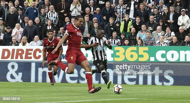 TYNE ENGLAND OCTOBER Newcastle United's Christian Atsu is tackled by Liverpool's Joel Matip during the Premier League match between Newcastle United...