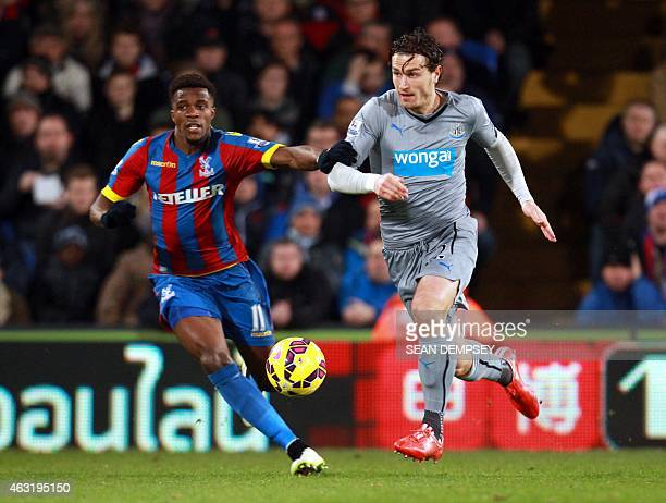 Newcastle United's Dutch defender Daryl Janmaat vies with Crystal Palace's Ivorianborn English striker Wilfried Zaha during the English Premier...