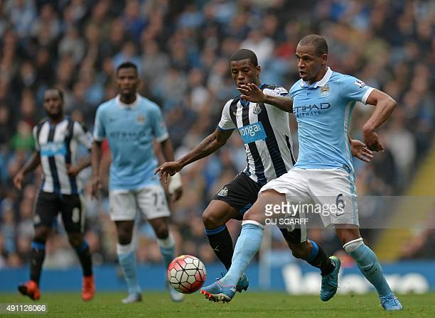 Newcastle United's Dutch midfielder Georginio Wijnaldum vies with Manchester City's Brazilian midfielder Fernando during the English Premier League...