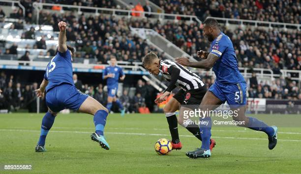 Newcastle United's Dwight Gayle under pressure from Leicester City's Harry Maguire and Wes Morgan during the Premier League match between Newcastle...