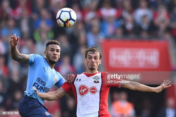 Newcastle United's English defender Jamaal Lascelles challenges Southampton's Italian striker Manolo Gabbiadini during the English Premier League...
