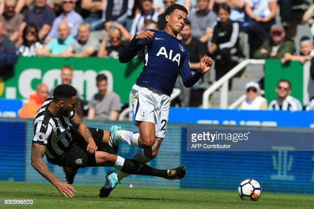 TOPSHOT Newcastle United's English defender Jamaal Lascelles tackles Tottenham Hotspur's English midfielder Dele Alli during the English Premier...