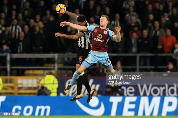 Newcastle United's English defender Jamaal Lascelles vies with Burnley's English striker Ashley Barnes during the English Premier League football...