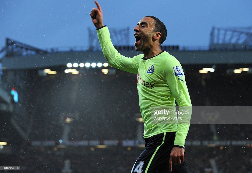 """Newcastle United's English defender James Perch celebrates after opening the scoring during the English Premier League football match between Manchester United and Newcastle United at Old Trafford in Manchester, north-west England on December 26, 2012. AFP PHOTO/ANDREW YATES USE. No use with unauthorized audio, video, data, fixture lists, club/league logos or """"live"""" services. Online in-match use limited to 45 images, no video emulation. No use in betting, games or single club/league/player publications"""