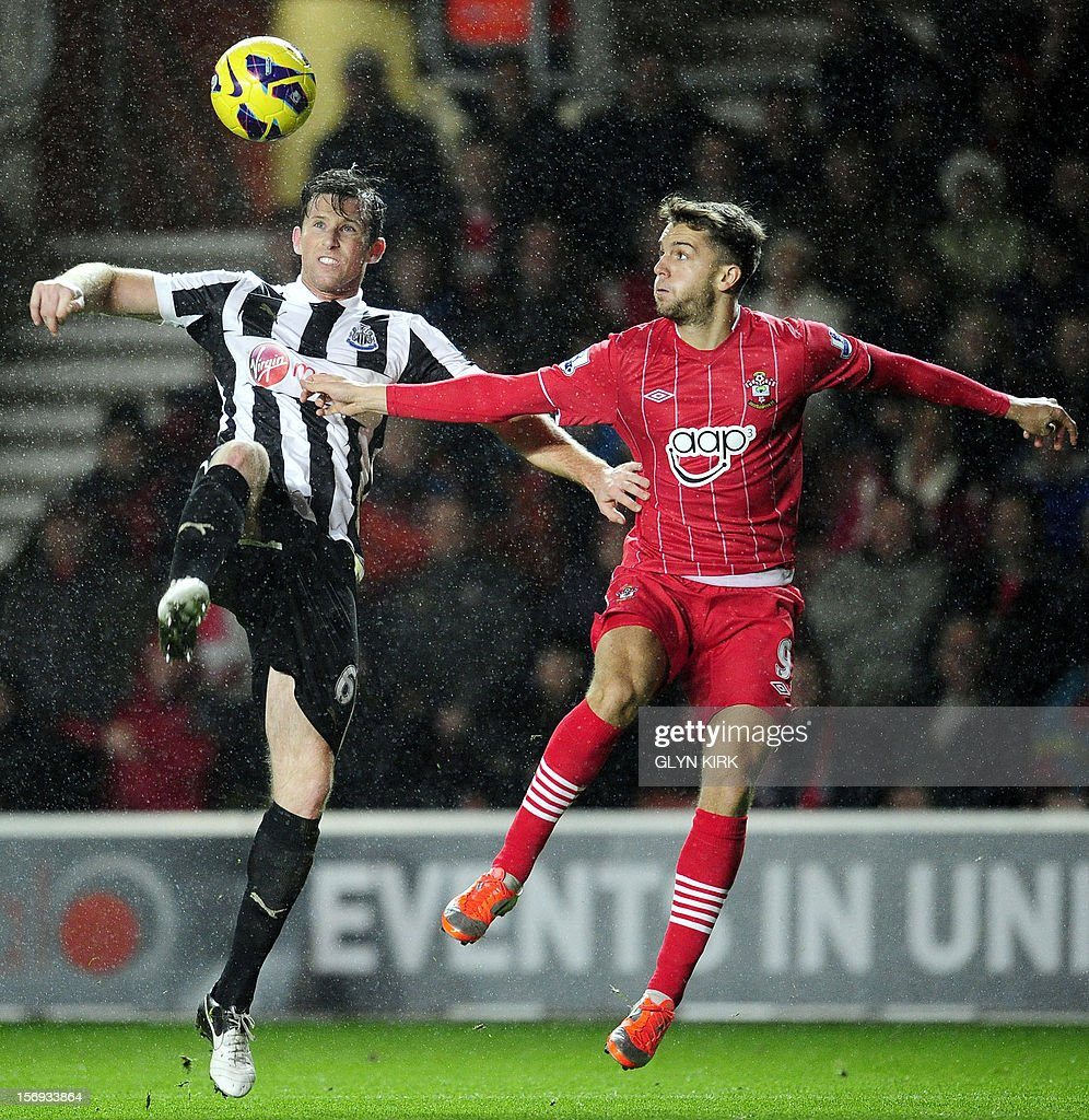 "Newcastle United's English defender Mike Williamson (L) challenges Southampton's English striker Jay Rodriguez (R) during their English Premier League football match at St. Mary's Stadium, Southampton, southern England, on November 25, 2012. Southampton won the match 2-0. AFP PHOTO/GLYN KIRK USE. No use with unauthorized audio, video, data, fixture lists, club/league logos or ""live"" services. Online in-match use limited to 45 images, no video emulation. No use in betting, games or single club/league/player publications."