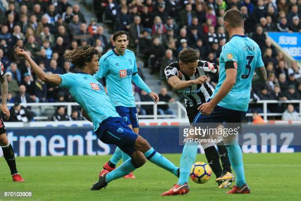 Newcastle United's English forward Dwight Gayle has a shot blocked by Bournemouth's Dutch defender Nathan Ake during the English Premier League...