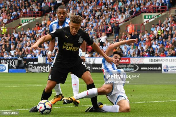 TOPSHOT Newcastle United's English forward Dwight Gayle is tackled in the penalty area during the English Premier League football match between...