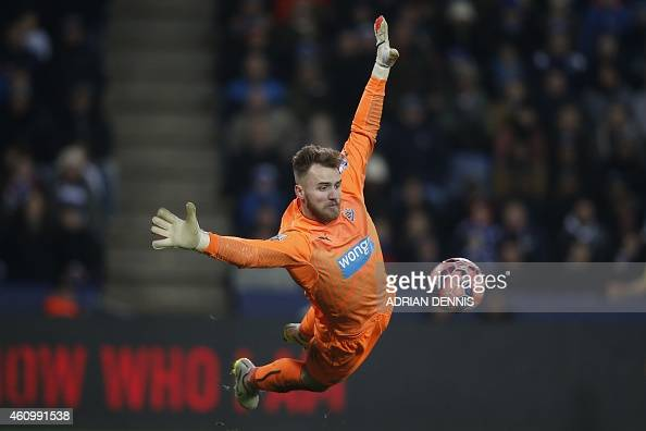 Newcastle United's English goalkeeper Jak Alnwick saves dives to save a shot during the English FA Cup third round football match between Leicester...