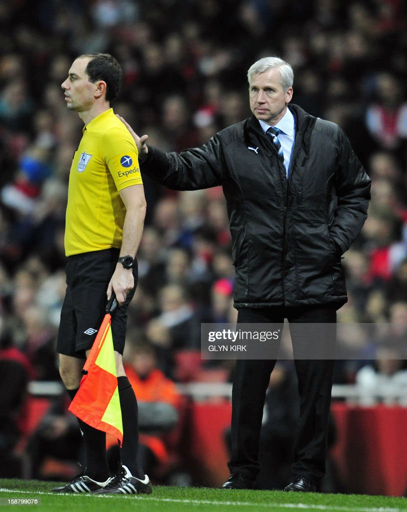 "Newcastle United's English manager Alan Pardew (R) gestures towards assistant referee Stephen Child (L) during the English Premier League football match between Arsenal and Newcastle United at The Emirates Stadium in north London, England on December 29, 2012. Arsenal won the game 7-3. AFP PHOTO/GLYN KIRK USE. No use with unauthorized audio, video, data, fixture lists, club/league logos or ""live"" services. Online in-match use limited to 45 images, no video emulation. No use in betting, games or single club/league/player publications."