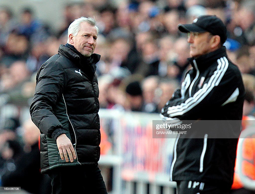 """Newcastle United's English manager Alan Pardew (L) looks at Stoke City's Welsh manager Tony Pulis during the English Premier League football match between Newcastle United and Stoke City at St James' Park in Newcastle Upon Tyne, northeast England, on March 10, 2013. USE. No use with unauthorized audio, video, data, fixture lists, club/league logos or """"live"""" services. Online in-match use limited to 45 images, no video emulation. No use in betting, games or single club/league/player publications."""