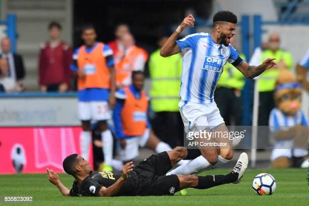 Newcastle United's English midfielder Isaac Hayden vies with Huddersfield Town's Danish midfielder Philip Billing during the English Premier League...