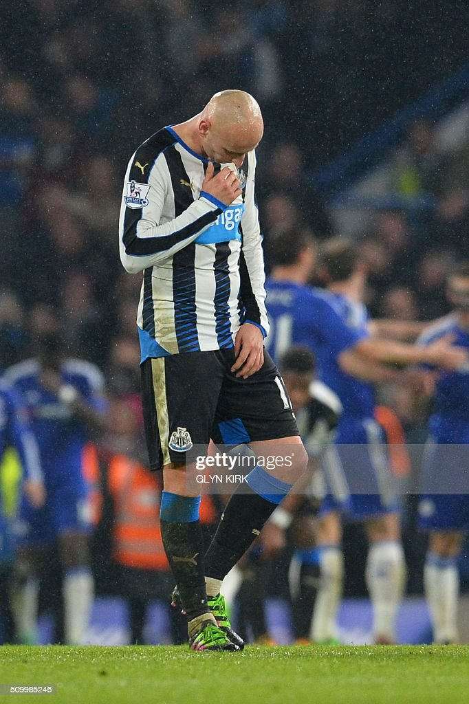 Newcastle United's English midfielder Jonjo Shelvey reacts after Chelsea scored their fifth goal during the English Premier League football match between Chelsea and Newcastle United at Stamford Bridge in London on February 13, 2016. / AFP / GLYN KIRK / RESTRICTED TO EDITORIAL USE. No use with unauthorized audio, video, data, fixture lists, club/league logos or 'live' services. Online in-match use limited to 75 images, no video emulation. No use in betting, games or single club/league/player publications. /