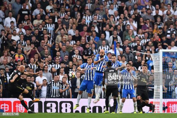 Newcastle United's English midfielder Jonjo Shelvey takes a freekick during the English Premier League football match between Brighton and Hove...