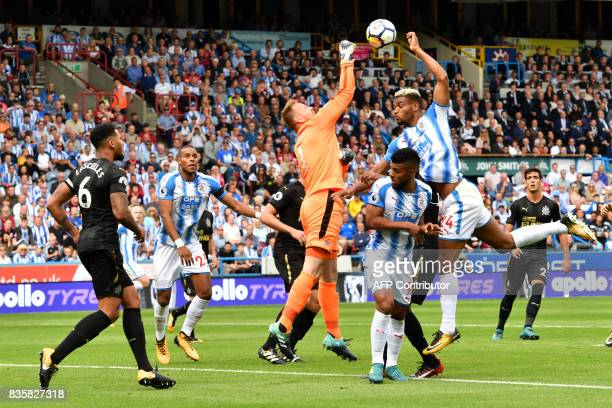 Newcastle United's Englishborn Irish goalkeeper Rob Elliot punches the ball clear during the English Premier League football match between...