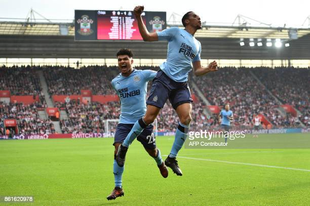 Newcastle United's Enlish midfielder Isaac Hayden celebrates scoring the opening goal with Newcastle United's US defender DeAndre Yedlin during the...