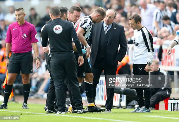 Newcastle United's Florian Lejeune leaves the pitch injured during the Premier League match at St James' Park Newcastle